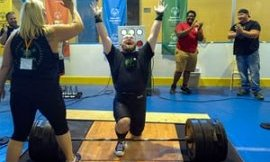 Andrew Dziezak celebrates his 450lb lift in power lifting.